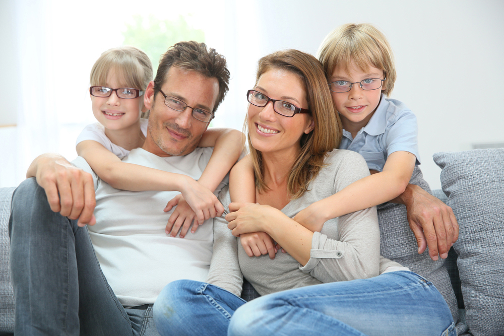 Family wearing prescription eyeglasses